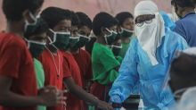 Daily coronavirus cases in India top 50,000 for first time