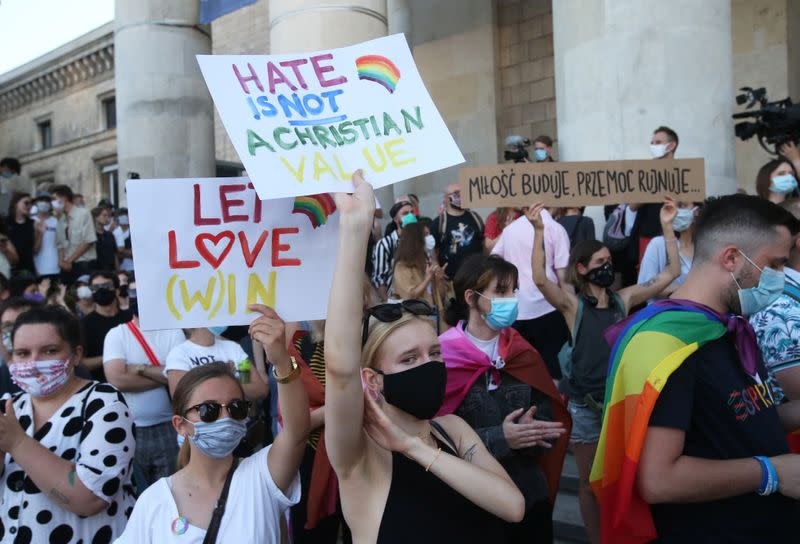 People take part in a rally in support of the LGBT community in Warsaw