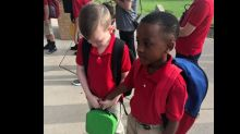 Photo of 8-year-old helping autistic classmate on first day of school goes viral
