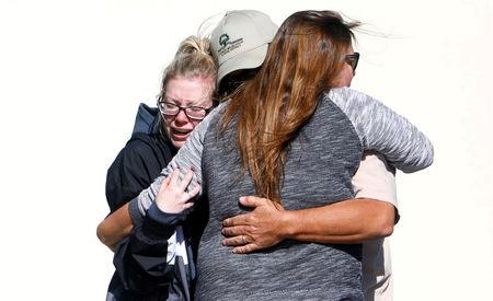 Mourners react outside a reception centre for families of victims of a mass shooting in Thousand Oaks