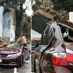 Echo Park mudslide takes down building wall, crushes cars