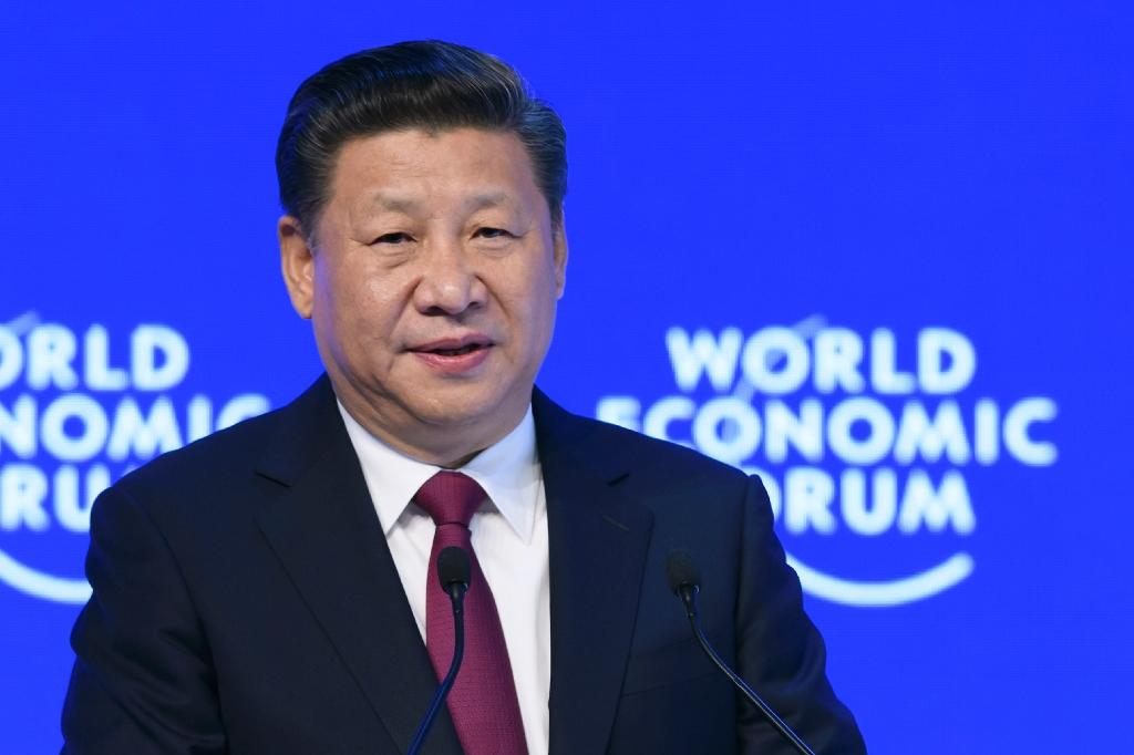 "In his Davos keynote speech, China's President Xi Jinping insisted China was committed to ""opening up"" (AFP Photo/Fabrice Coffrini)"