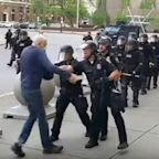 An entire 57-person Buffalo Police Department team resigned en masse to support fellow officers suspended for pushing a 75-year-old protester to the ground