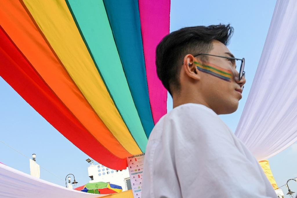 Around 600 revellers joined the first-ever Pride boat parade in Yangon (AFP Photo/YE AUNG THU)