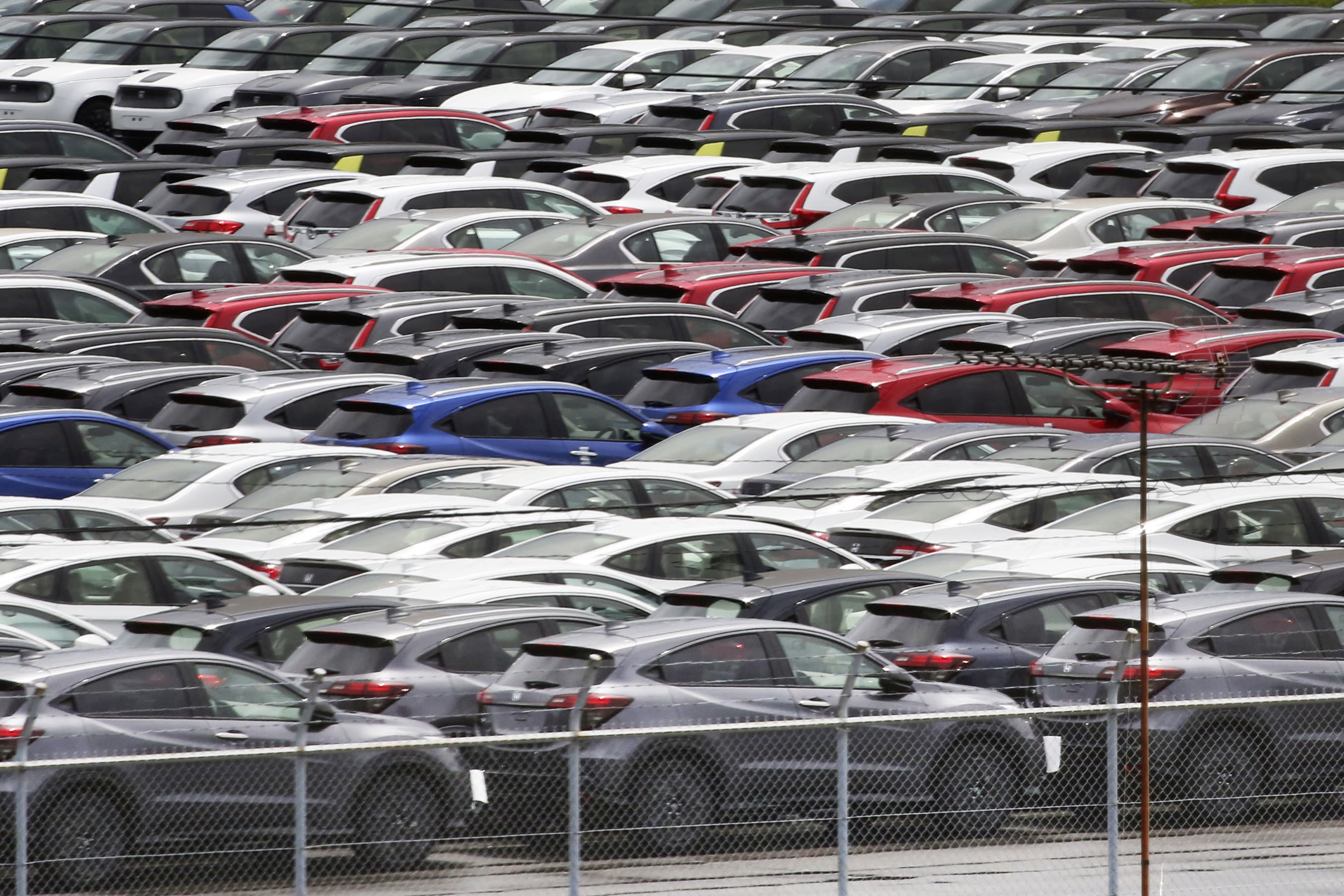 Cars to be exported are parked at a port in Yokohama, near Tokyo, on July 6, 2020. Japan's trade surplus widened in August as the pandemic pummeled a wide array of industries and sapped consumer demand, according to preliminary data from the Finance Ministry released Wednesday, Sept. 16, 2020. (AP Photo/Koji Sasahara)