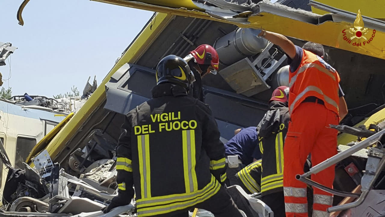 <p>Italian firefighters Vigili del Fuoco inspect the wreckage of two commuter trains after their head-on collision in the southern region of Puglia, killing several people, Tuesday, July 12, 2016. (Italian Firefighter Press Office via AP) </p>