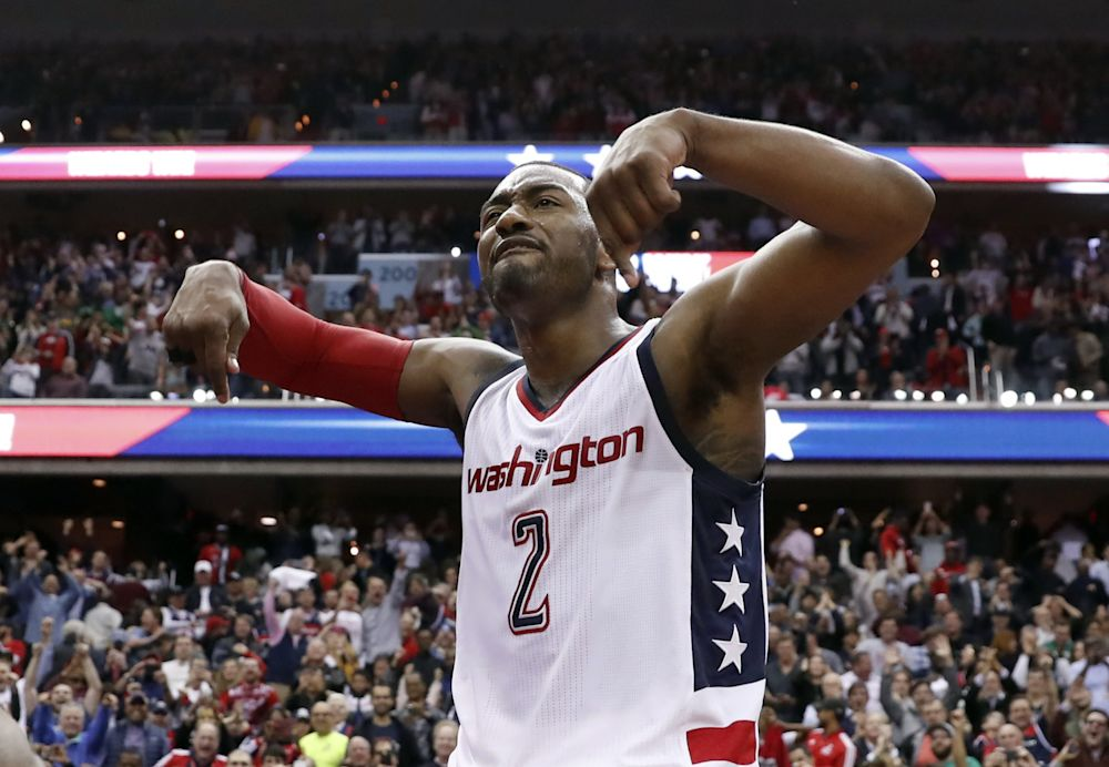 John Wall felt all the emotions after his game-winning shot Friday night. (AP)