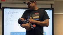Professor holds student's newborn so she could take notes in class:  'Family, village, community'