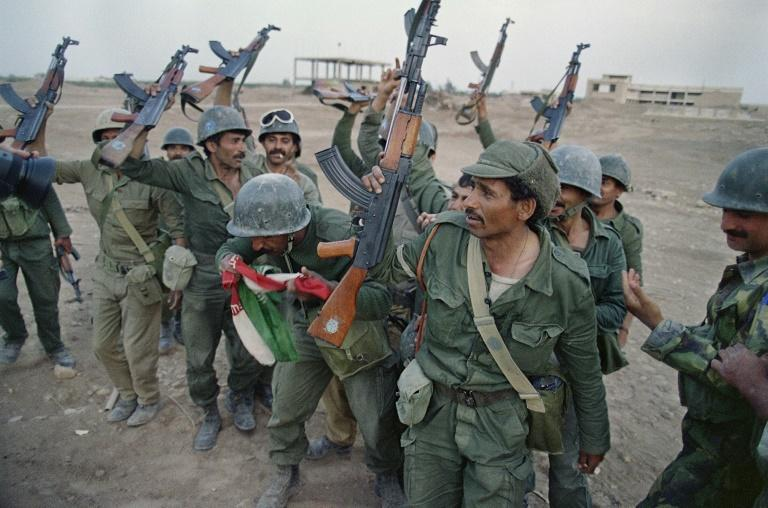 Both sides launched major offensives against each other causing massive destruction, with this April 20, 1988 photograph showing Iraqi soldiers celebrating after a victory