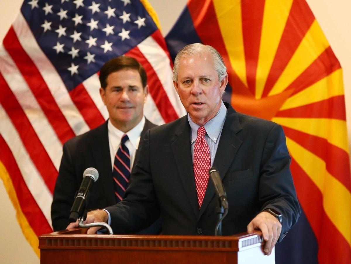 Dr. Robert C. Robbins, president of the University of Arizona, and Arizona Gov. Doug Ducey give an update on the COVID-19 pandemic response Tuesday, April 14, 2020. Robbins said the university will allow more in-person classes next week.