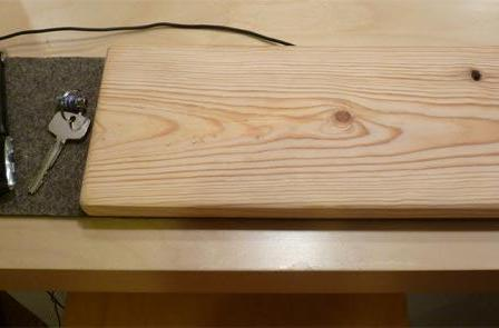 Powermat retrofitted into plank of wood, new world of opportunies discovered