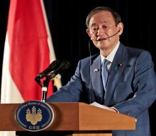 Japan's Suga opposes actions that boost tension in South China Sea