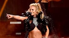 Fan makes Britney Spears crack up at her concert when he asks 'who is it?' before her hit 'Gimme More'