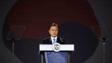 South Korea ready for talks with Japan to improve ties, Moon tells Suga