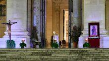 Stunning photos show Pope Francis praying to an empty St. Peter's Square amid the coronavirus