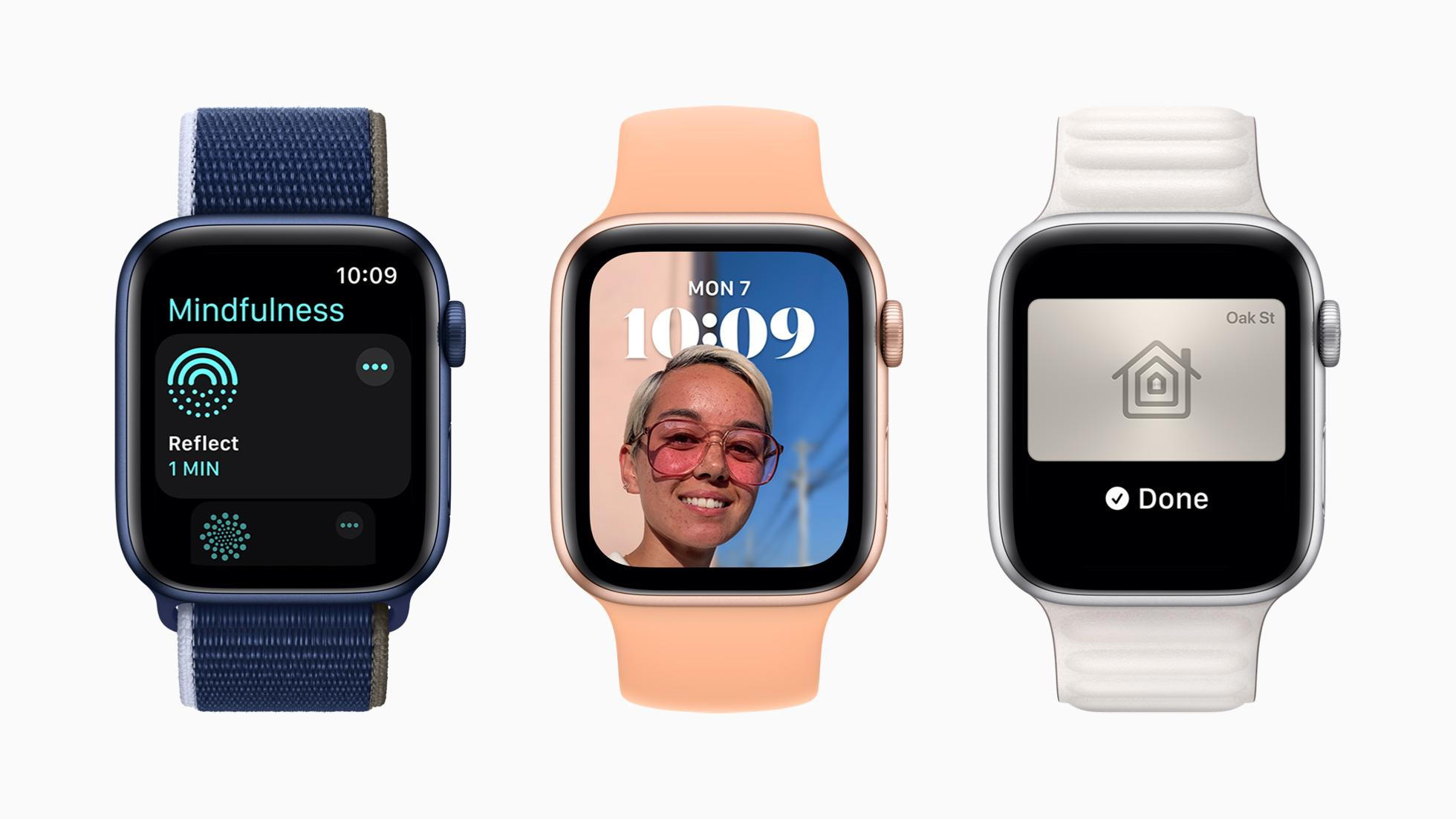Three Apple Watches each showing a new feature from watchOS 8. From left to right: The new Mindfulness app, a new Portrait watch face and a home key.