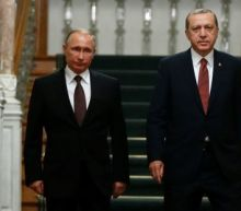 Russia and Turkey sign gas deal, seek common ground on Syria as ties warm