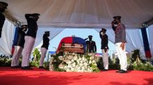 Dignitaries rush to cover as protests flare at Haiti president's funeral