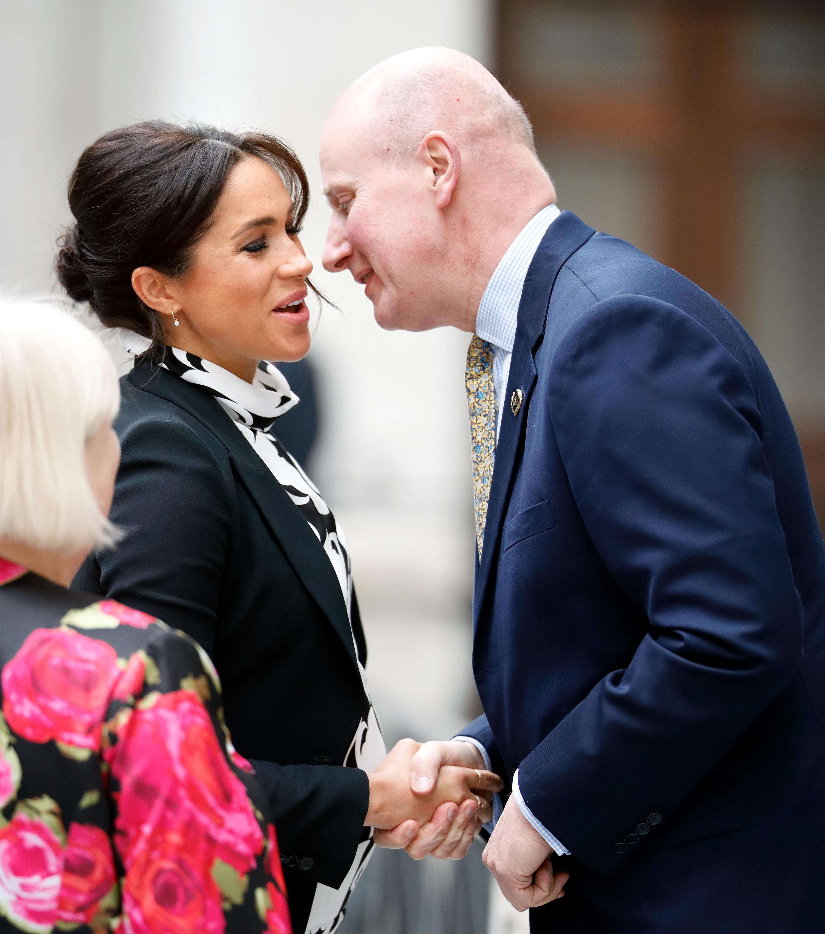 Queen rehires aide to 'keep an eye' on Meghan Markle