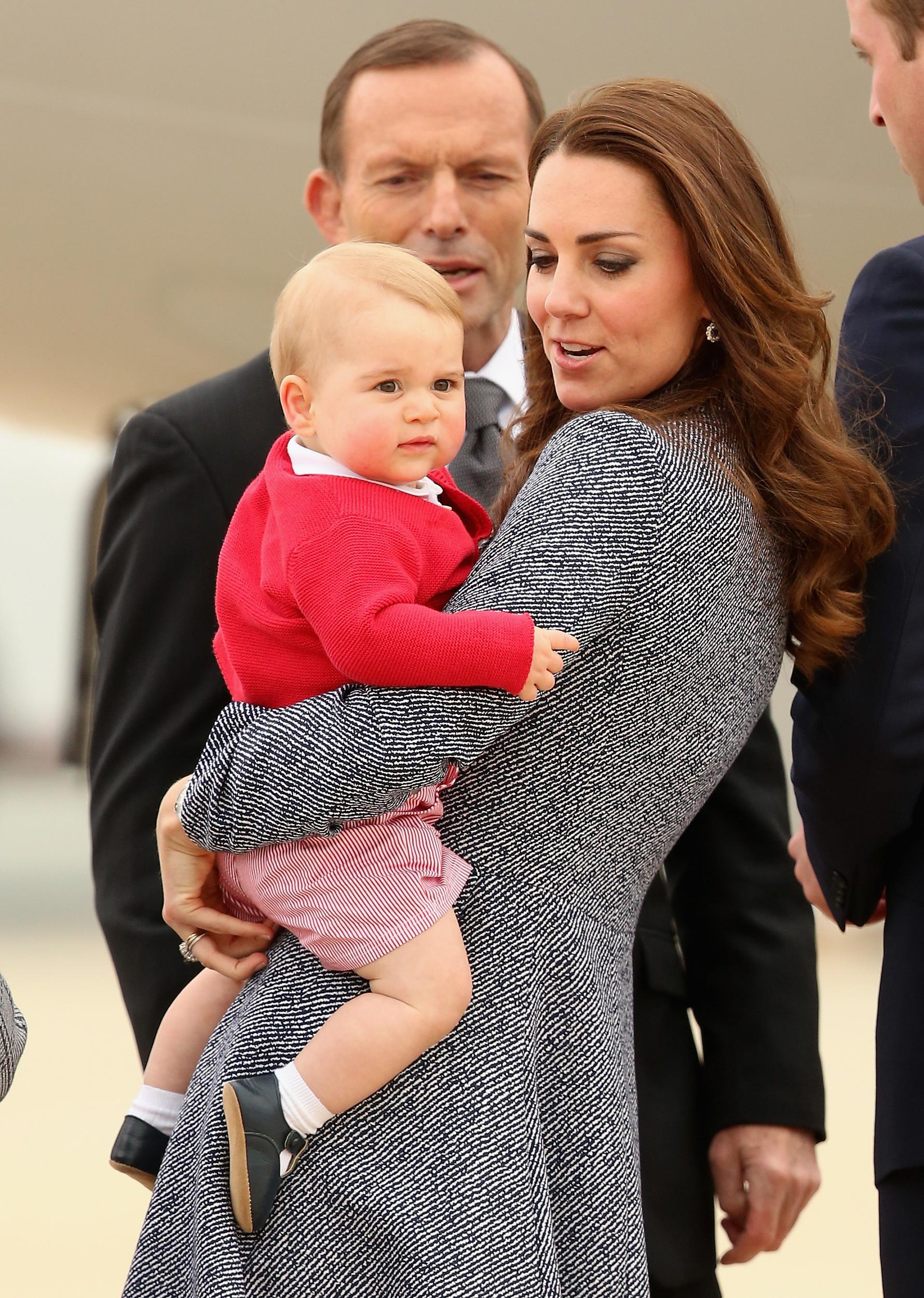 Catherine, Duchess of Cambridge holds Prince George of Cambridge as they leave Fairbairne Airbase to head back to the UK after finishing their Royal Visit to Australia.