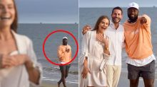 NBA champion accidentally photobombs engagement shoot