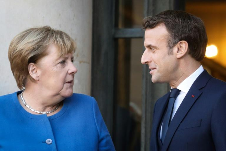 Taking EU helm, Germany's Merkel calls on Europe to show resolve