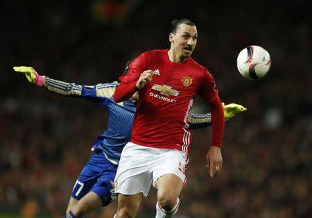 Manchester United's Zlatan Ibrahimovic goes past FC Rostov's Nikita Medvedev