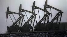 Oil holds steady ahead of market data