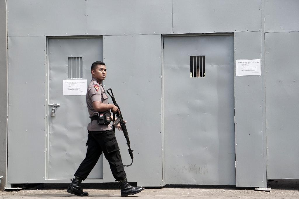 A policeman patrols on July 25, 2016 outside the only entrance to Indonesia's highest security Nusakambangan prison in Cilacap, home to a high-security prison where the country conducts executions (AFP Photo/Bayu Nur)