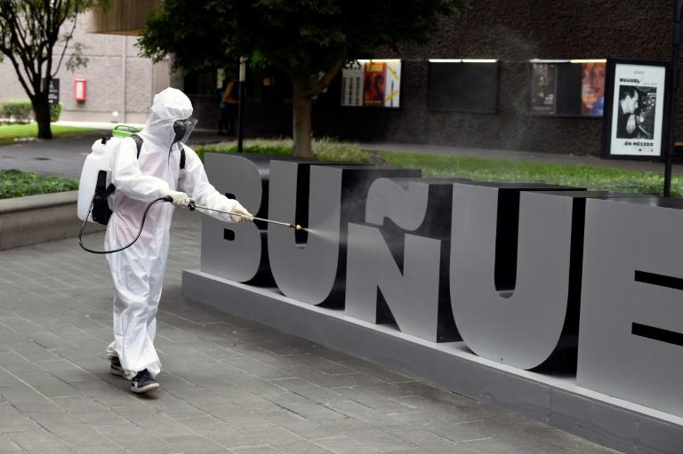 A worker sanitizes an area of the Cineteca Nacional in Mexico City