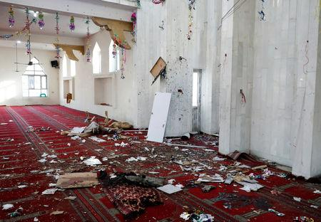 Hats are seen inside a mosque after a blast in Kabul, Afghanistan May 24, 2019. REUTERS/Omar Sobhani