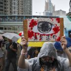 Hong Kong protesters march in rain to demand democracy