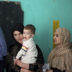 The Latest: Amid violence, Afghan elections draw to a close
