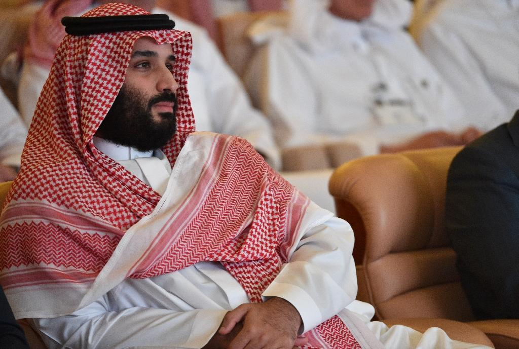 Saudi Crown Prince Mohammed bin Salman was excluded from a list of 17 people hit with US sanctions over the murder of journalist Jamal Khashoggi, but two top aides were on it