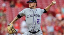 Reds hit 5 homers, extend Rockies' road woes with 11-5 win