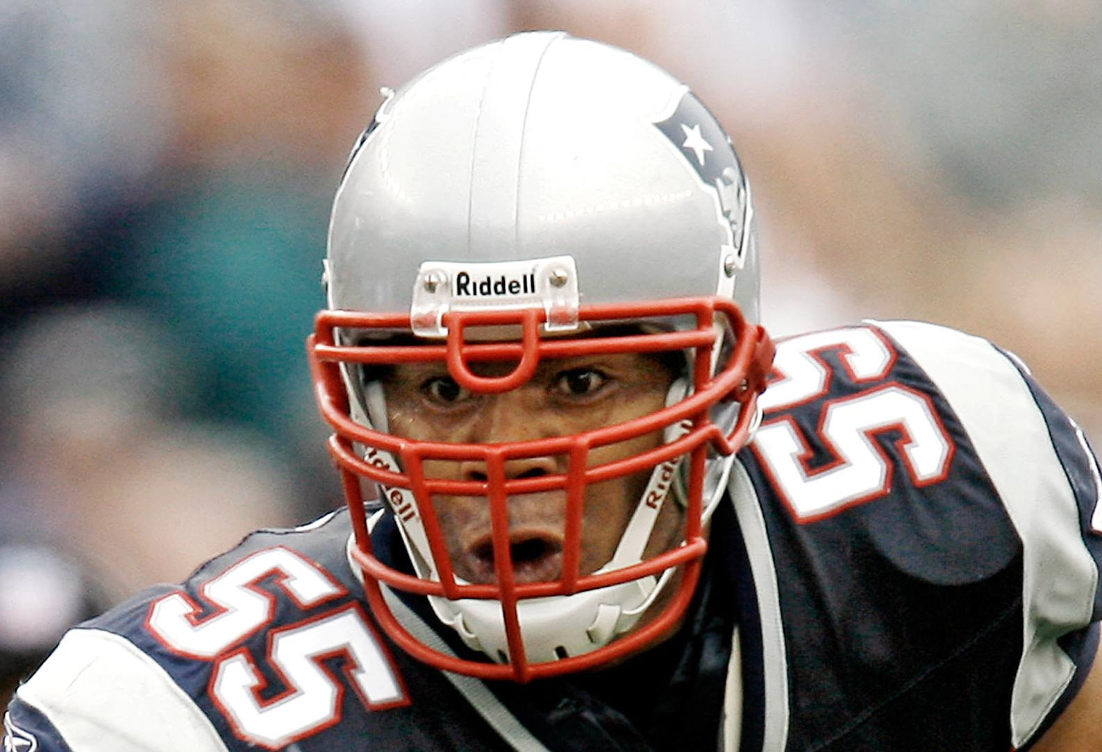 FILE - In this Oct. 7, 2007 file photo, New England Patriots linebacker Junior Seau runs with the ball after an interception during New England's 34-17 win over the Cleveland Browns in a football game at Gillette Stadium in Foxborough, Mass. Senior U.S. District Judge Anita Brody in Philadelphia, announced Thursday, Aug. 29, 2013, that the NFL and more than 4,500 former players want to settle concussion-related lawsuits for $765 million. The plaintiffs include at least 10 members of the Pro Football Hall of Fame, along with and the family of Seau, who committed suicide last year. The global settlement would fund medical exams, concussion-related compensation and medical research. (AP Photo/Winslow Townson, File)