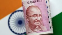 No rebound for India's reeling rupee seen likely in coming year: Reuters poll