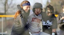 High school softball players praised for helping injured opponent complete home run