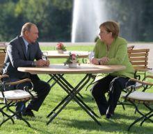 Tough talks, no agreements at Merkel, Putin meeting near Berlin