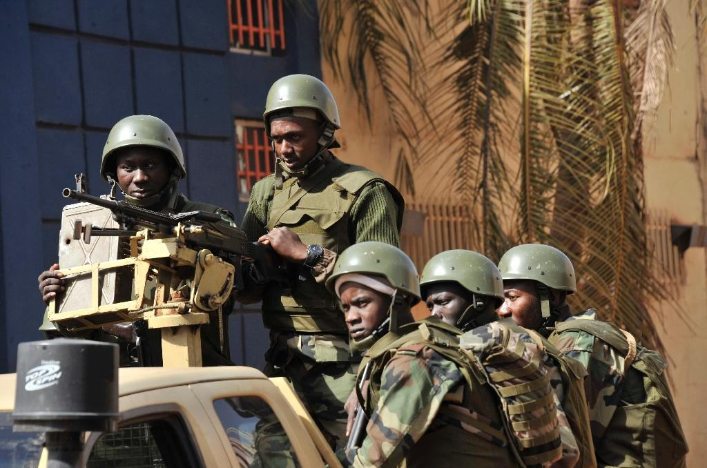 Malian troops patrol outside the Radisson Blu hotel in Bamako on November 21, 2015 in the wake of the previous day's siege (AFP Photo/Habibou Kouyate)