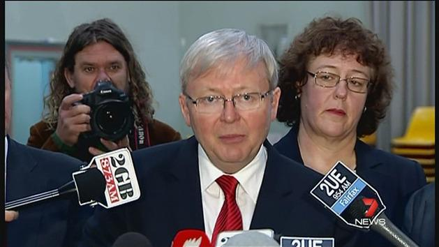 Protesters confront Kevin Rudd