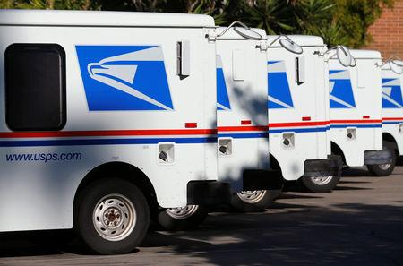 FILE PHOTO: U.S. postal service trucks sit parked at the post office in Del Mar, California