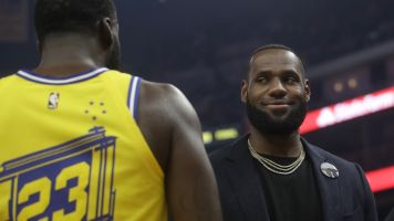 LeBron tries to hide his laughter at Dray ejection