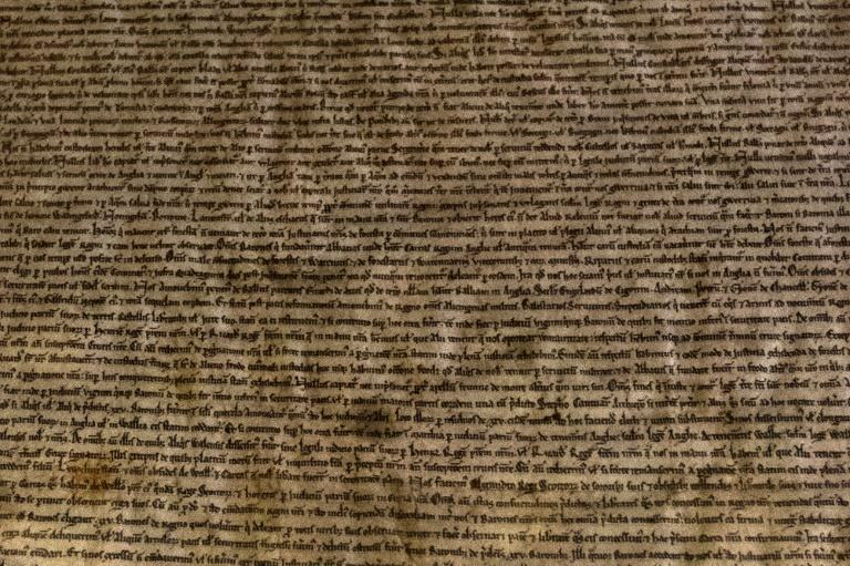 Lines of manuscript are seen in the Salisbury Cathedral 1215 copy of the Magna Carta while it was displayed at the Houses of Parliament in London in February 2015