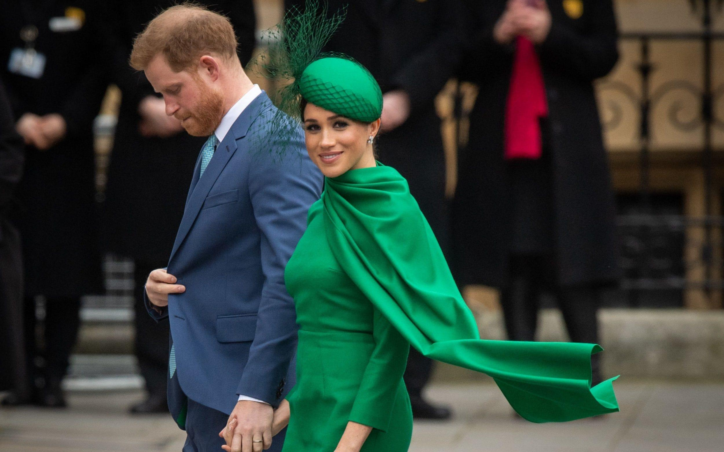 The Duke and Duchess of Sussex, wearing Emilia Wickstead, at their final public appearence as senior working royals in March - Getty