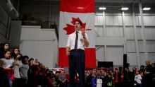 Trudeau, Scheer dodge questions, trade barbs on final push to election day