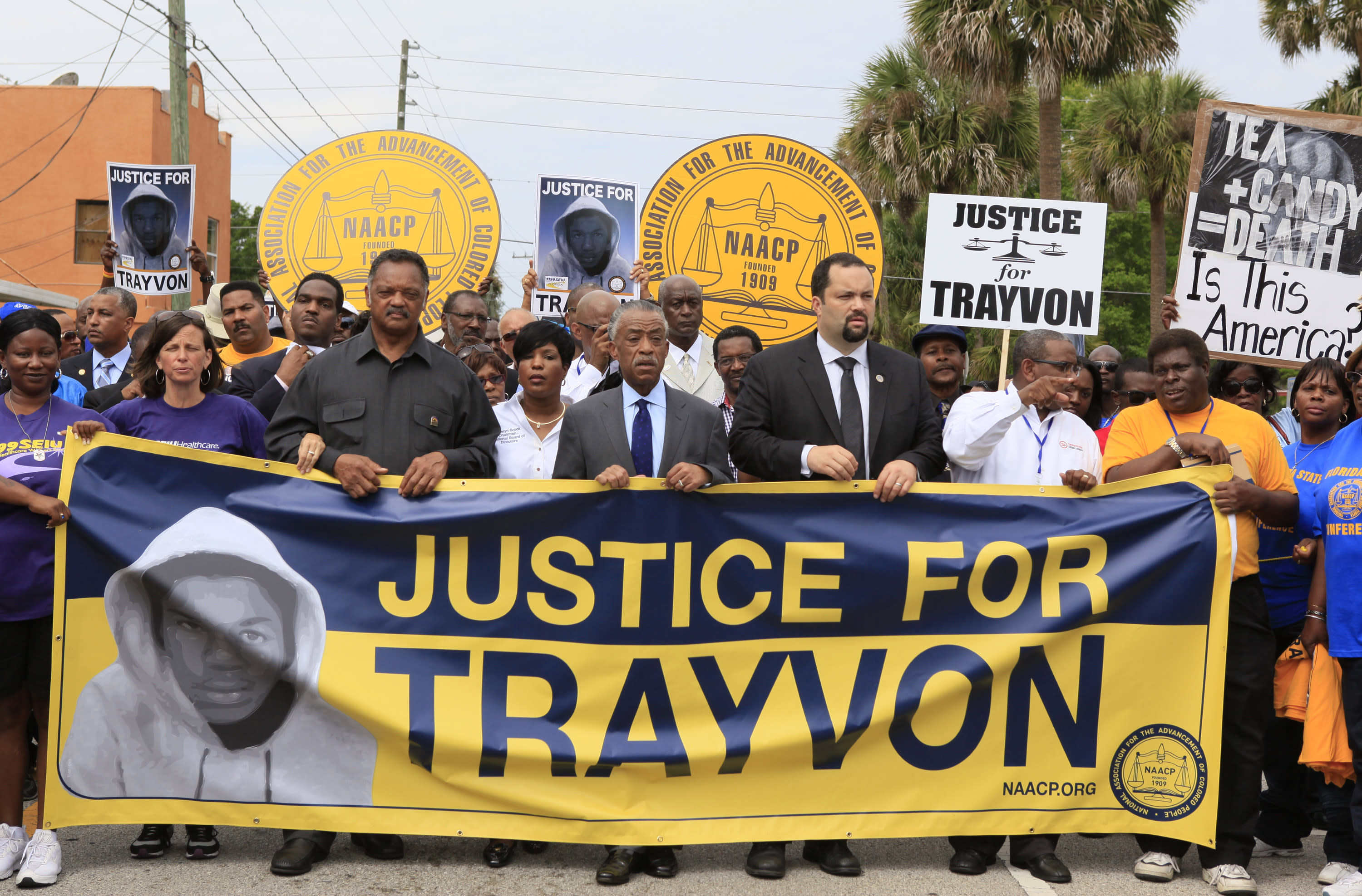 """From left, Rev. Jesse Jackson, Rev. Al Sharpton, and Benjamin Jealous, President of the NAACP lead the march for slain Florida teenager Trayvon Martin on Saturday, March 31, 2012 in Sanford, Fla. Protesters carried signs, chanted """"Justice for Trayvon,"""" and clutched the hands of their children while they walked from Crooms Academy of Information Technology, the county's first high school for black students, to the Sanford Police Department. The march was organized by the NAACP and was one of several taking place over the weekend. Martin was shot to death by 28-year-old George Zimmerman on Feb. 26 as he walked from back from a convenience store to his father's fiancée's home in a gated community outside Orlando. (AP Photo/Julie Fletcher)"""