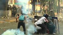 Protesters scuffle with police in Venezuela