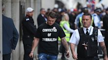Protesters clash with police and press as Tommy Robinson jailed for nine months