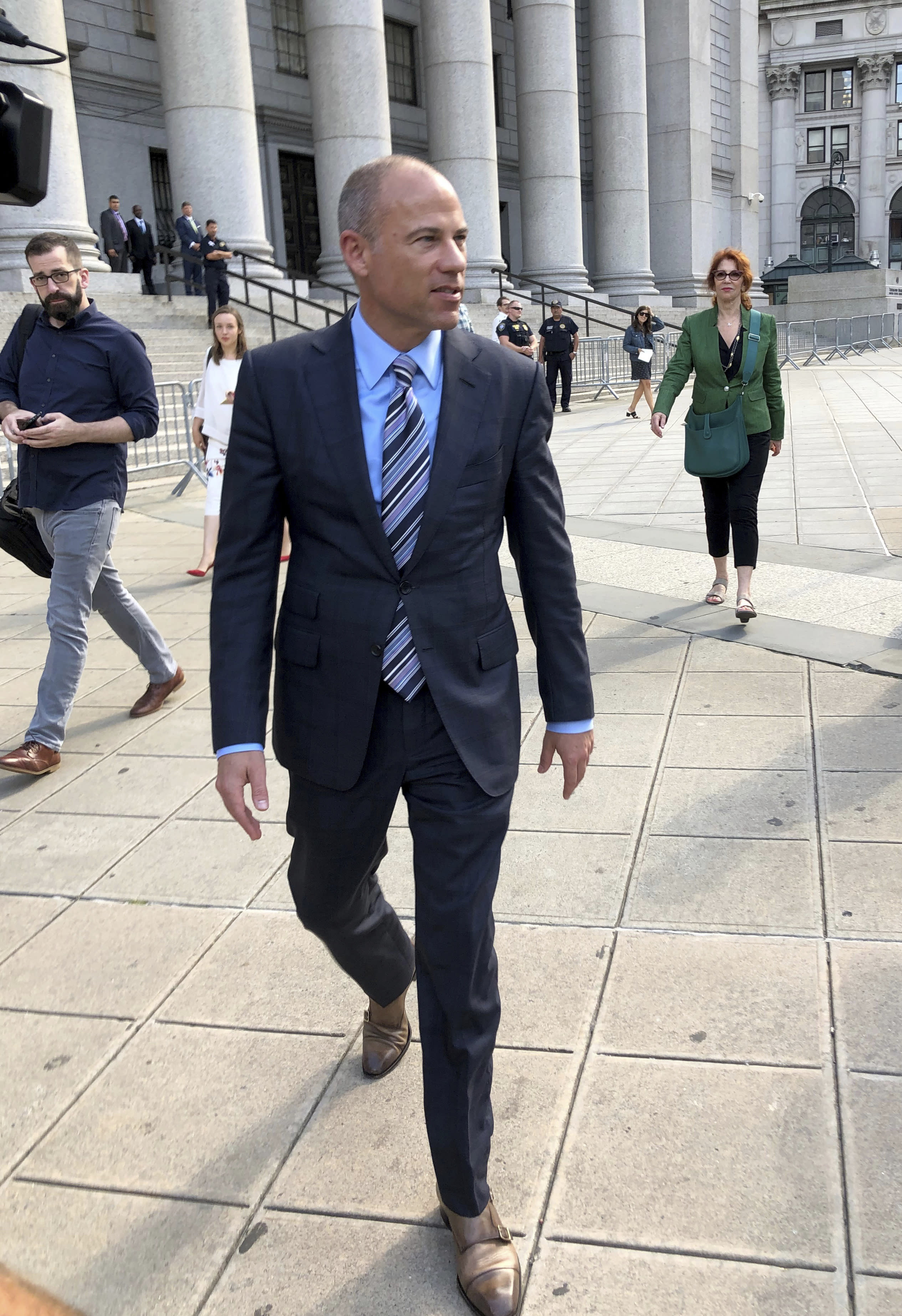 Attorney Michael Avenatti walks past the federal courthouse in New York after making an appearance related to the extortion charges against him, Thursday, Aug. 22, 2019. (AP Photo/Larry Neumeister)